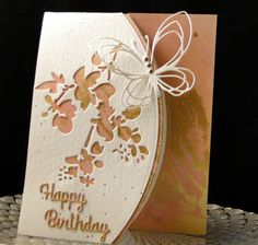 Nina Bday February 2017 Top fold card with Tim Holtz Media die. Walter and Winnie Butterfly, Happy Birthday from China. Mauve paper with gold foil from a paper stack at Hobby Lobby. Created by Peggy Dollar