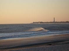 Cape May Lighthouse at sunset, from the beach by the Jetty Motel.
