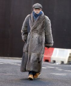 Baby it's cold outside: Eric Clapton stepped out wearing a giant fur coat on Monday