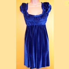 Free People Velour Empire Waist Dress Size L FREE PEOPLE Size L Blue Velvet Empire Waist, Full Elasticized Bodice Free waist  100% Authentic Gently worn (There is a small hole the size of a pinhead, I just noticed while taking pics)  90% Polyester, 10% Spandex (feels like velvet)  Machine Wash Cold From a smoke free home *Bundle me pls I'm lonely. Free People Dresses Mini