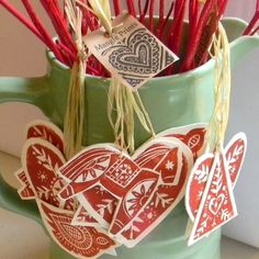 Scandinavian Christmas tree decorations. Hand printed on white card, in a beautiful rich red oil based ink