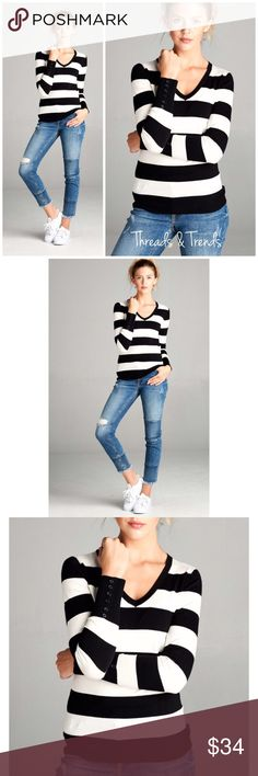 Black & White V Neck Sweater Classic go to must have sweater. Black and white stripe, V neckline and button detail cuffs. Made of rayon/poly blend. S, M, L XL Sweaters V-Necks