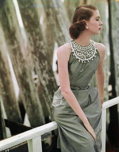Suzy Parker wearing a light gray dress by Cohama, 1951