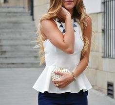 Peplum/graphic necklace/studded clutch
