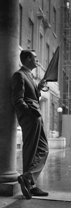 Cary Grant on Rainy Street very handsome actor                                                                                                                                                                                 More