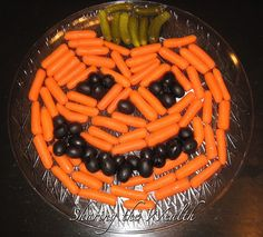 Jack-O-Lantern Veggie Tray (maybe celery for the top instead of pickles? and maybe some red peppers to frame it?)