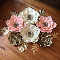 A personal favorite from my Etsy shop https://www.etsy.com/listing/513968664/6pcs-paper-flower-set