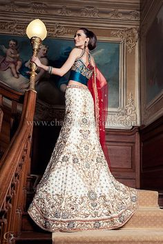 White, heavy embroidery lengha, green and red