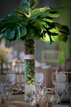 Monstera Leaves and Brussell Sprouts create this over the top tropical centerpiece.
