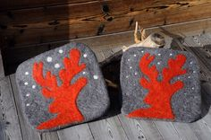 Wetfelted cushions with deer in the snow made by my sister and me. September  2014 in Bramberg