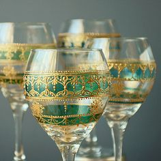 Buy used glassware, use gutta/glass paints and decorate with henna borders. OR buy these Handpainted Moroccan Inspired Wine Glasses by LITdecor, $80.00 (ETSY)