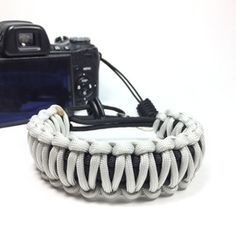 Silver Gray DSLR Camera safety strap. Easy to wear, tangle free, super strong, and very light. Want one in your favorite colors, or team colors? Hit me up. www.stupidstraps.com #papabearshouse #stupidstraps #straps #camerastrap #strap #camera #550 #strong #dslr #safetystrap #safety #photography #custom #handmade #nikon #madetoorder #canon #sony #photographer #black #silver #gray #grey #silvergray #paracord #paracordporn