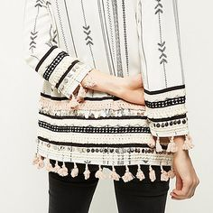 Lightweight fabric White and black embroidery  Festival style Relaxed fit Unfastened front Pom pom trim