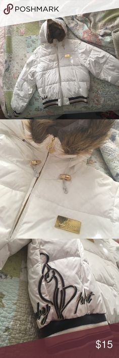 Baby Phat parka Pre-owned and loved ❤️ very comfy and warm parka. Fur is detachable. Perfect for winter time. Needs a new home. Baby Phat Jackets & Coats Puffers