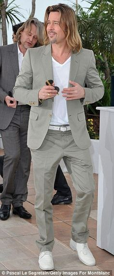 Epitome of cool: Brad Pitt showed up to promote movie Killing Them Softly in a light coloured suit matched with a white T-shirt and white pumps. Brad showed off his longer hair style, which has now grown to just above his shoulders, while he wore his facial hair in a goatee style. He drew the crowds as he showed up in his effortless style while hordes of fans tried to get a glimpse of the actor. via dailymail.co.uk