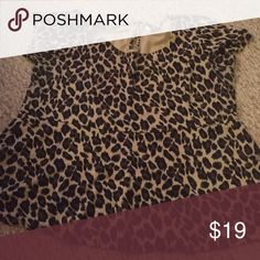 Plus size peplum top animal print Plus size peplum top. Back has a key hole closure at the top. Short sleeves. Worn once. torrid Tops Blouses