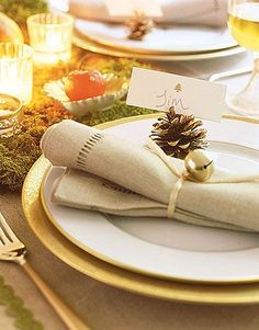 Jingle Bell Place Setting    White china rimmed with gold stands out against gold-hued chargers, while jingle bells add a festive twinkle to each guest's plate.