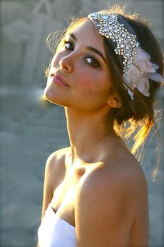 We love this vintage inspired headpiece and her skin is glowing. She has the perfect amount of makeup on her eyes to accentuate her beautiful face.