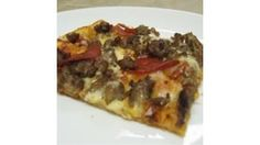 Use your bread machine to make a thin, chewy, flavorful pizza crust with just a few basic ingredients.