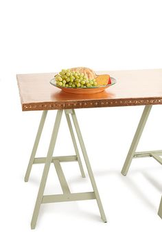 to make this copper topped trestle table we used contact cement and