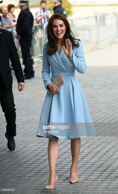 News Photo : Britain's Catherine, Duchess of Cambridge smiles...