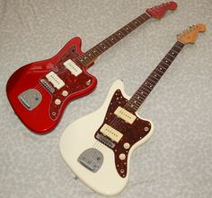 The Candy Apple Red one is a CIJ, while the Olympic White one is a mid MIJ, probably Candy Apple Red, Candy Apples, Red Apple, Fender Guitars, Sick, Goodies, Japanese, Guitars, Sweet Like Candy