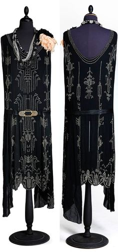 Evening gown, Biby Fideikommiss, Gillberga parish, Södermanland County, Sweden, circa 1920s. Black chiffon with foliated glass stones in geometric patterns. Belt of black moiré, metal buckle with black and foiled glass stones. Via Stockholms Auktionsverk.
