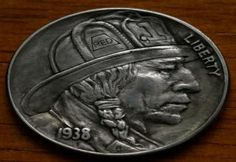 """A unique collection of awesome and artistically carved US coins, commonly referred to as """"Hobo Nickels""""."""