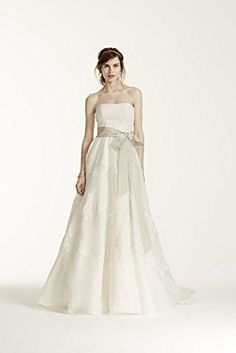 Strapless satin organza ball gown features antique-inspired lace. Exquisite combinations of Guipure and Chantilly lace are hand-cut and applied in an allover organic pattern on Champagne tulle for ad...