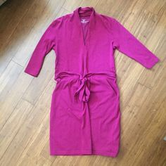 Patagonia dress Pre-loved 3/4 sleeve Patagonia dress. It's like a magenta color. Has pockets and attached ties at the waist. It's in good used condition. There's a little makeup on the neckline, I'll wash it (and hang dry) if you would like ... I know some people are particular about detergents.  **Smoke-free/pet-friendly, offer button pls, Q's welcome** Patagonia Dresses