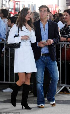 July 1, 2007: Kate Middleton with her brother, James Middleton at the concert for Diana at Wembley Stadium in London. Kate wore a white 'Olivia' trench coat by Reiss and black knee-high boots.