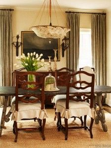 Classic wood furniture, a neutral color palette of golden beige and taupe gray, and a selective use of accessories lend a more masculine look in this dining room. Read more at http://bhgrelife.com/romantic-revival-tips-for-dramatic-and-formal-dining-rooms
