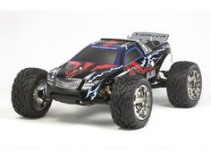 The new Tamiya R/C Vajra Model Kit is the latest in a long line of off road 4WD radio controlled racing trucks in 1/10 scale.  This is an electric R/C assembly kit of a 4WD racing truck. The main chassis platform is a 15mm longer wheelbase version of the basic chassis of the Avante 2011 and is matched with 100mm diameter V-pattern block tires. The truck uses a new 2.0mm thick carbon fiber lower & upper deck.