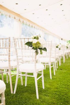 white chivari chairs under starry tent // photo by David Jenkins Photography, flowers by Fiona Perry // View more: http://ruffledblog.com/english-fusion-wedding/