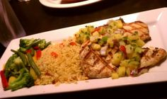Under 600 calorie meal: 2 juicy 5oz char-grilled Chicken Breasts, pineapple/jalapeno pico de gallo, spicy rice, YUM!