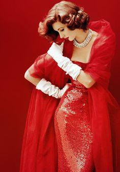 Suzy Parker in red sequined dress by Norman Norell, photo by Milton Greene, 1952