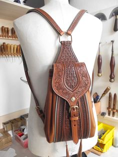Hand tooled backpack from French saddler Jean-Luc Parisot, Parisotsellier.com