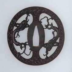 Tsuba with design of confronted rain dragons within a ring of clouds  Japanese, Edo Period, Late 18th century  By Ono Mitsutaka, Japanese, MFA
