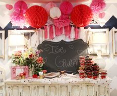 Beautiful ice cream bar at a Valentine's Day Party. Other great party menu, game, and invitation ideas on post.