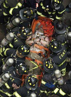 ~ New York City Fire Fighters in Full Bunker Gear Rescue A Survivor of The Attacks on The World Trade Center. Never Forget We Will Never Forget, Lest We Forget, Always Remember, Don't Forget, Remember 911, World Trade Center, Fire Dept, Fire Department, 11 September 2001
