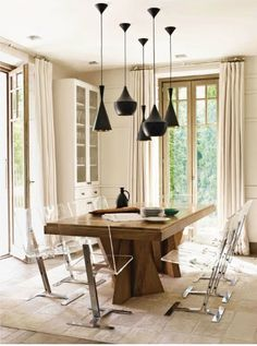 ahhh.. dining delight. Just might add a rustic chandi instead, but LOVE this look and those doors and curtains to floor !