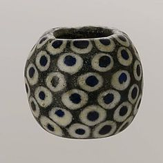 Greek, Eastern Mediterranean glass eye bead, ca. 4th century BCE Culture: Greek, Eastern Mediterranean. Dimensions: Diam.: 1 1/4 in. (3.2 cm) Metropolitan Museum of Art~