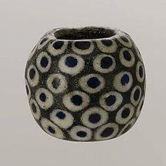 Greek, Eastern Mediterranean glass eye bead, ca. 4th century BCE Culture: Greek, Eastern Mediterranean. Dimensions: Diam.: 1 1/4 in. (3.2 cm) Metropolitan Museum of Art~
