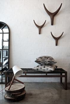 Dark wood bench with a woven seat and Africa inspired patterned pillows