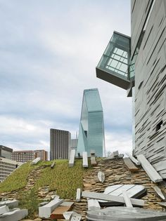 Perot Museum of Nature and Science, Dallas:  On the plinth roof, Morphosis, working with Talley Associates, created a garden of local stone and vegetation, where precast elements like those found in the cube seem to have fallen off the building.