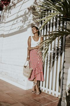 A lovely European day with an above the ankles red & white check ruffle bottom wrap, white tank, perfect Summer straw bag, + gold or silver and white lace-up espadrilles. Sunnies and a sun-friendly wide brim hat add the perfect finishing touches.