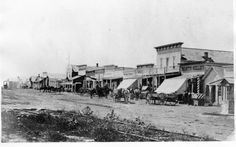 View of Front Street in Dodge City, Kansas. Taken between 1870 and 1880 View of Front Street in Dodge City, Kansas. Taken between 1870 and 1880 Dodge City Kansas, Kansas Usa, Kansas City, Oklahoma, Old Western Towns, Old West Town, Old West Photos, Into The West, Le Far West