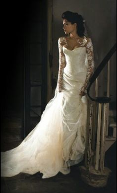 Gorgeous lace sleeved wedding dress. This is SO beautiful! If I absolutely had to pick my favorite wedding gown of all time this just might be it.