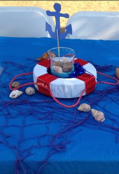 Life saver centerpieces with fish netting and shells. Sailor Baby Showers, Anchor Baby Showers, 2nd Baby Showers, Sailor Party, Sailor Theme, Jordan Baby Shower, Baby Boy Shower, Birthday Party Centerpieces, Shower Centerpieces
