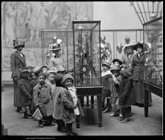 A kindergarten class from Public School 116 visiting the Arms and Armor galleries of the Metropolitan Museum of Art, 1913